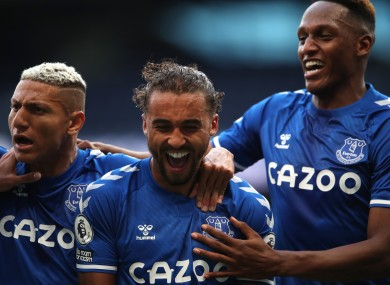 Calvert-Lewin celebrates his goal with Richarlison (left) and Yerry Mina (right.)