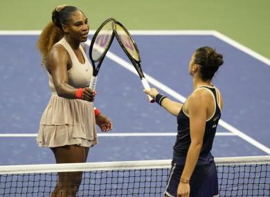 Serena Williams taps rackets with Margarita Gasparyan.
