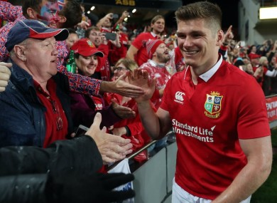 Kicking on: Owen Farrell in Lions' red.