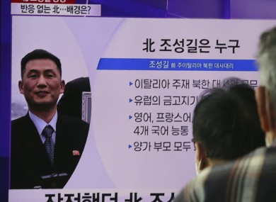 People watch a TV showing an image of Jo Song Gil, the North Korea's former ambassador to Italy, during a news programme at the Seoul Railway Station.
