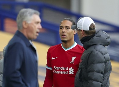 Liverpool manager Jurgen Klopp checks on Virgil van Dijk as he leaves the field during the game against Everton.