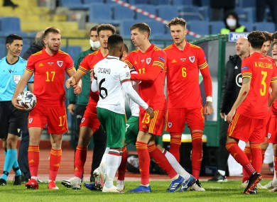Bulgaria's Cicinho clashes with Wales players.