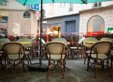 An empty terrace of a Paris bar.