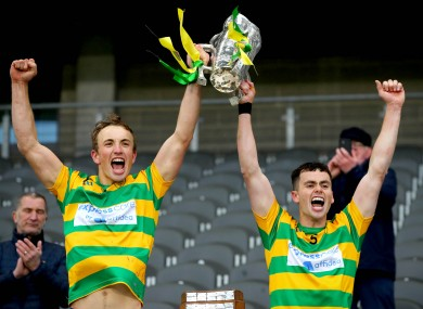 Blackrock's Michael O'Halloran and Cathal Cormack liftt the trophy.