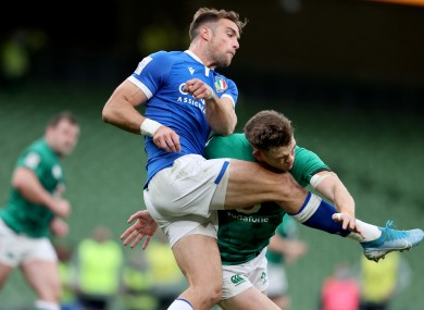Ringrose catches Edoardo Padovani's knee in the face while attempting a chargedown.