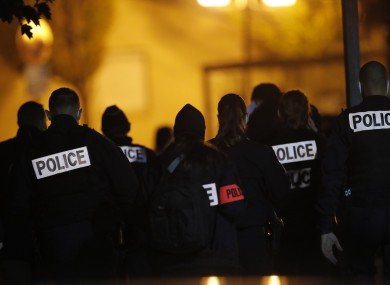 French police officers gather outside the high school in Conflans-Saint-Honorine, north of Paris.