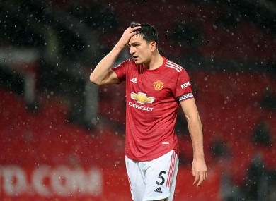 Harry Maguire reacts to United's draw.