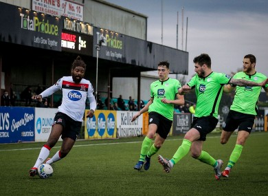 Dundalk's Nathan Oluwa is closed down by Harps defenders.
