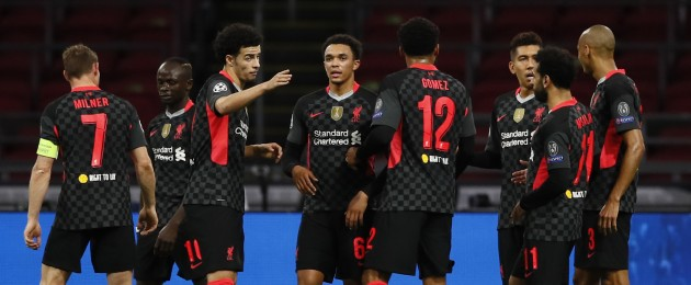 Liverpool players celebrate their first-half goal.