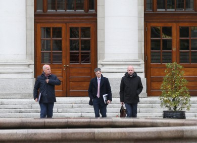 Tony Holohan, Ronan Glynn and Philip Nolan leaving Government Buildings yesterday.