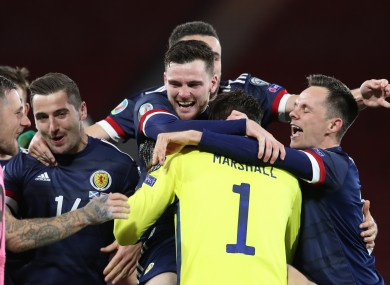 Andy Robertson leads the Scotland celebrations.