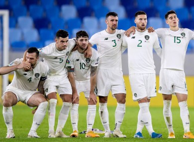 The Irish team watch on during last night's penalty shootout.