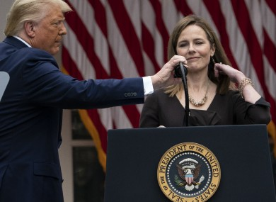 President Donald Trump adjusts the microphone after he announced Judge Amy Coney Barrett as his nominee to the Supreme Court