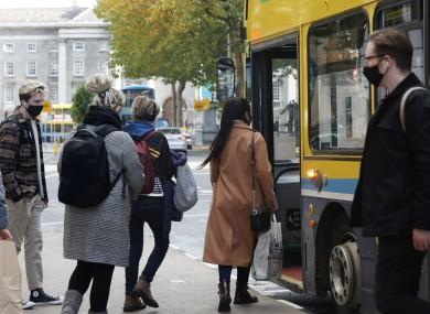 People boarding a bus in Dublin last month.