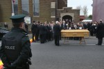 The funeral of prison officer Adrian Ismay in north Belfast.