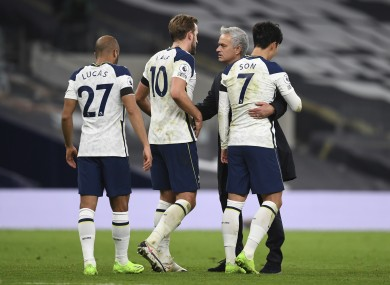 Jose Mourinho embraces Harry Kane, Heung-min Son and Lucas Moura after the win over Man City.