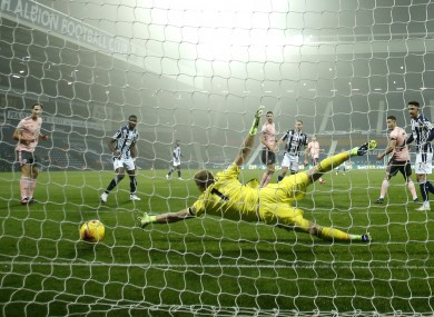 Sheffield United's goalkeeper Aaron Ramsdale fails to stop a goal by West Bromwich Albion's Conor Gallagher.