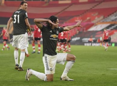 Edinson Cavani celebrates scoring yesterday.