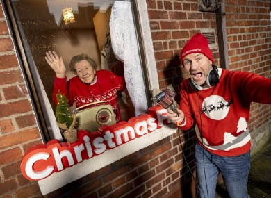 Alone service user Rosaleen Sheehan is pictured in her home in Ringsend, Co Dublin, with Garvan Rigby, co-founder of Christmas FM.