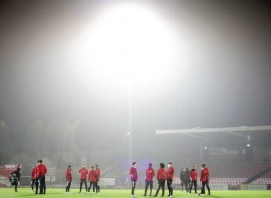 Derry City players inspect the pitch before the game against Cork City.
