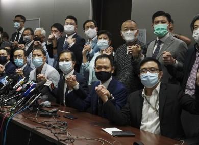 Hong Kong's pro-democracy legislators pose a picture before a press conference at Legislative Council in Hong Kong.