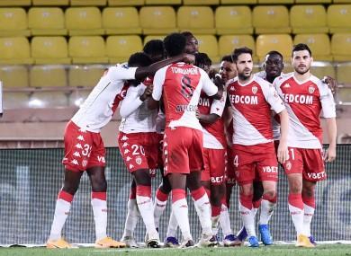 Monaco players celebrate a goal.