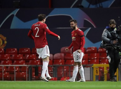 Bruno Fernandes (R) celebrates his first goal with Victor Lindelof.