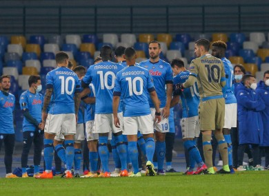 Napoli players take to the field with Maradona's 10th shirt.