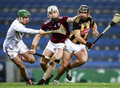 Kilkenny's Richie Hogan in action against Galway's Eanna Murphy and Shane Cooney.