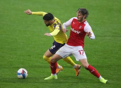 Sadlier (right) tackles Huddersfield Town's Pipa this season.
