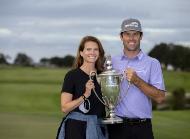 Robert Streb and his wife Maggie Streb hold aloft the RSM Classic trophy.