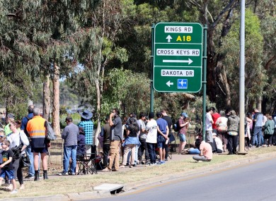 People are seen queuing at the Covid-19 testing site at Parafield Airport in Adelaide