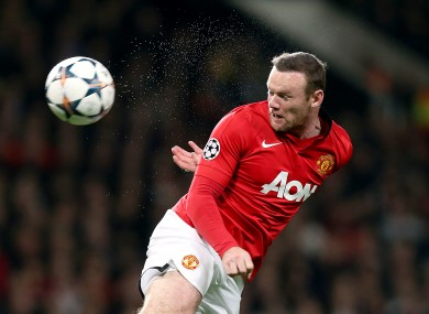Wayne Rooney heading the ball during his time with Man United.