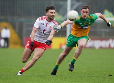 Tyrone's Tiernan McCann with Donegal's Ciaran Thompson.