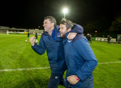 Drogheda United manager Tim Clancy celebrates with assistant boss Kevin Doherty after clinching promotion against Cabinteely.