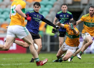 Mayo's Tommy Conroy scores a goal despite the efforts of Aidan Flynn of Leitrim.