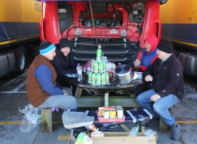 Polish lorry drivers share Christmas Day food and drinks at a truck stop near Folkestone, Kent