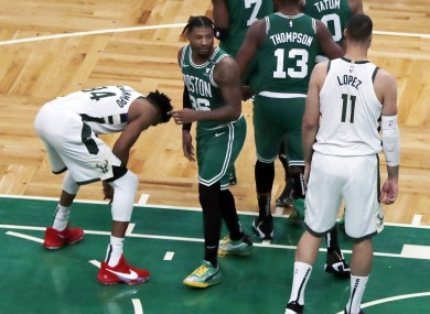 Giannis Antetokounmpo reacts after missing his second free throw  with less than a second left on the clock.