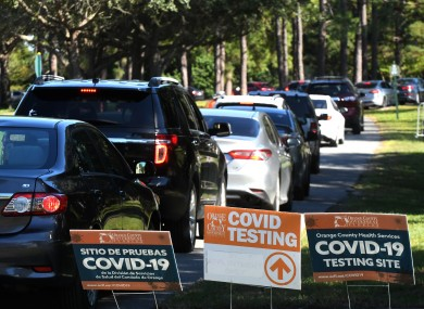 Card queuing at a rapid Covid-19 testing site in the US last month.