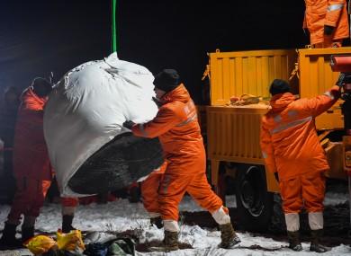 Staff members transport the return capsule of China's Chang'e-5 module