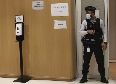 A police officier guards the courtroom at the Paris Hall of Justice today
