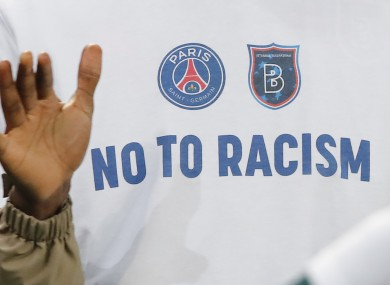 A 'No To Racism' logo on the shirt of Basaksehir assistant coach Pierre Webo.