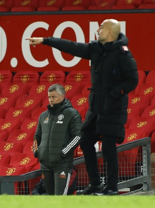 Ole Gunnar Solskjaer watches on as Pep Guardiola issues instructions.