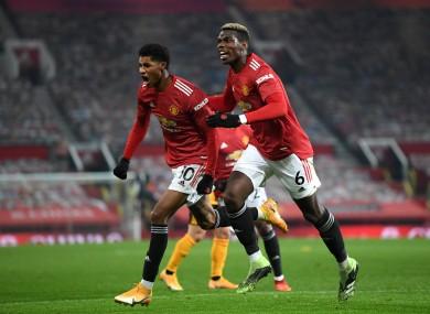 Marcus Rashford and Paul Pogba celebrate United's late winner.