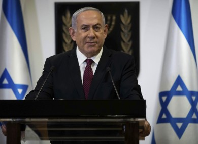 Israeli Prime Minister Benjamin Netanyahu delivers an address announcing the dissolution of Israel's government
