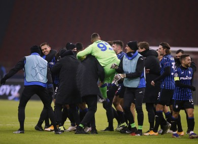 Atalanta players celebrate at the final whistle.