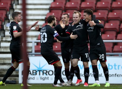 Lincoln City's Anthony Scully (second right) celebrates scoring (file pic).