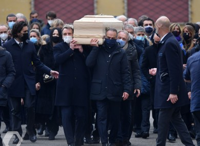 Former Ireland assistant manager Marco Tardelli and teammates from the 1982 World Cup-winning Italy side carry the coffin of Paolo Rossi yesterday.