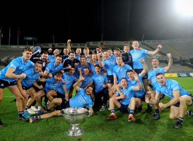 The Dublin team celebrate with the Sam Maguire.