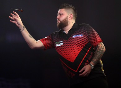 Michael Smith throwing darts this evening.